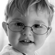 Photo of a toddler wearing glasses