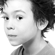 Photo of a preteen boy with spiked hair